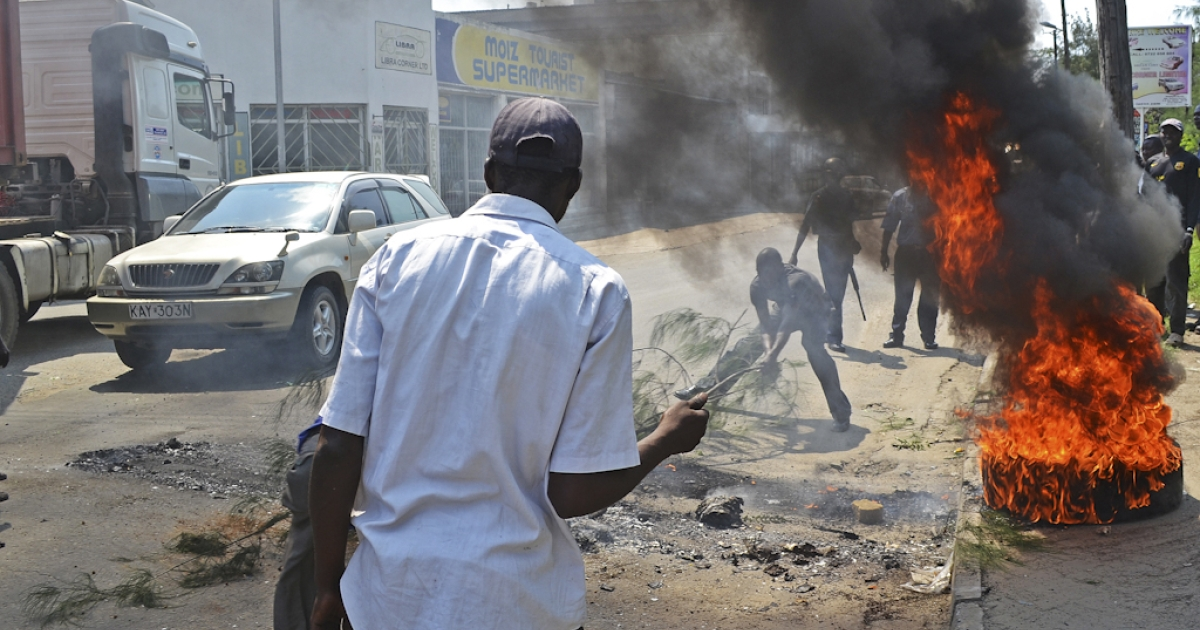 Rioters burn tyres in Kenya's port city of Mombasa for a second day after the killing of an extremist cleric linked to Al-Qaeda-allied Shebab militants on August 28, 2012. Hundreds of angry youths have reportedly thrown stones, damaged cars after amassing in support of slain preacher Aboud Rogo Mohammed near the centre of Mombasa. The cleric, who was shot dead on August 27, 2012 by