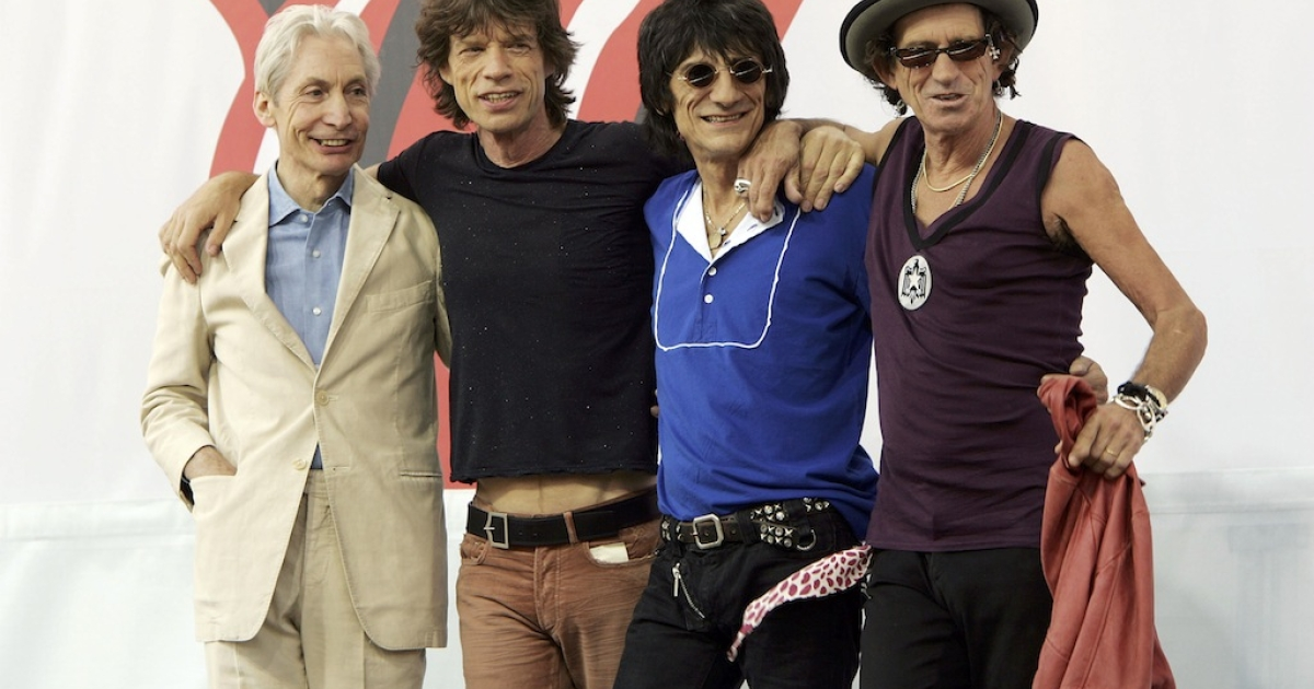 Charlie Watts, Mick Jagger, Ron Wood, and Keith Richards of The Rolling Stones pose for a photo during a press conference to announce a world tour at the Julliard Music School May 10, 2005 in New York City.</p>