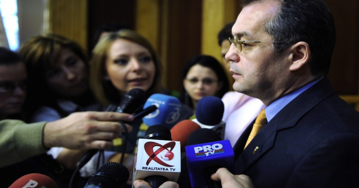 Emil Boc (R) addresses the media shortly after Romanian President Traian Basescu presented him as the new designated Prime Minister at the Romanian Parliament Palace in Bucharest, on Dec. 15, 2008.</p>