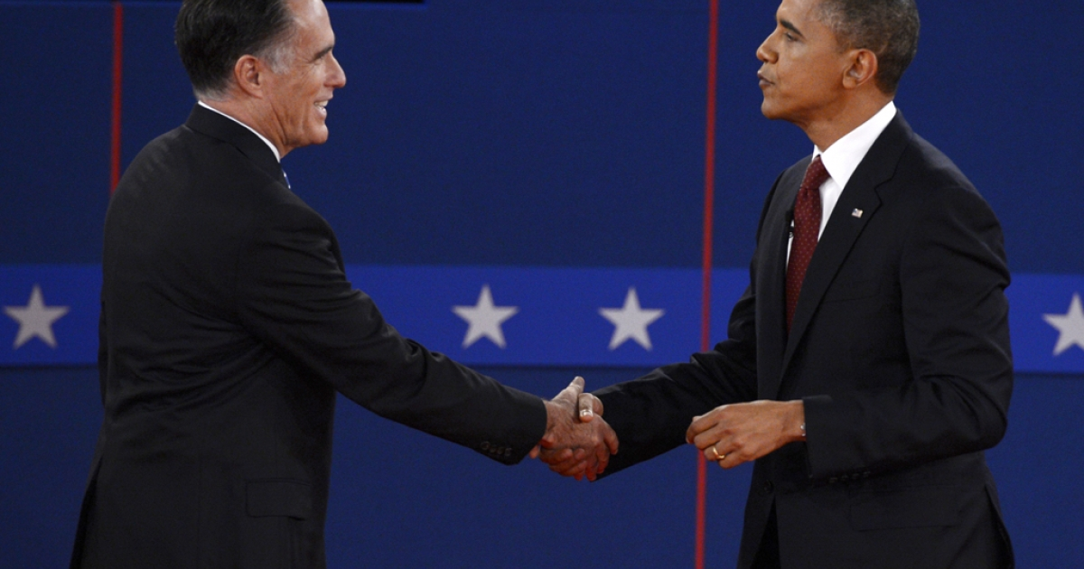 US President Barack Obama and Republican presidential candidate Mitt Romney shake hands following the second presidential debate at the David Mack Center at Hofstra University in Hempstead, New York, October 16, 2012.</p>