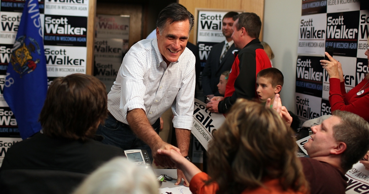Republican presidential candidate Mitt Romney greets volunteers at a phone bank for Wisconsin Gov. Scott Walker in Fitchburg, Wisc., on Mar. 31, 2012.</p>