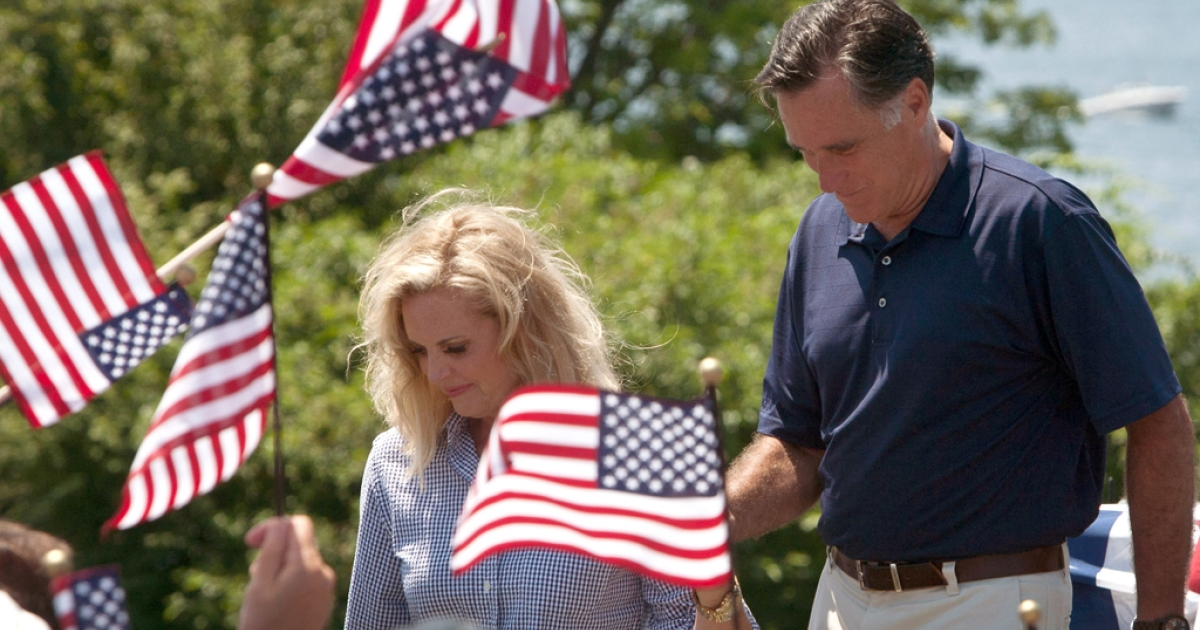 Republican presidential candidate Mitt Romney with his wife Ann during the July Fourth parade in Wolfeboro, New Hampshire. The Romney's took a break from their vacation to march in the parade.</p>