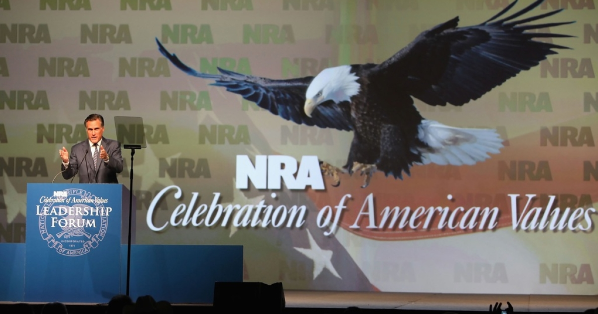Mitt Romney speaks at the 138th National Rifle Association of America meetings on May 15, 2009 in Phoenix, Arizona. Romney's position on gun control has evolved substantially over time.</p>