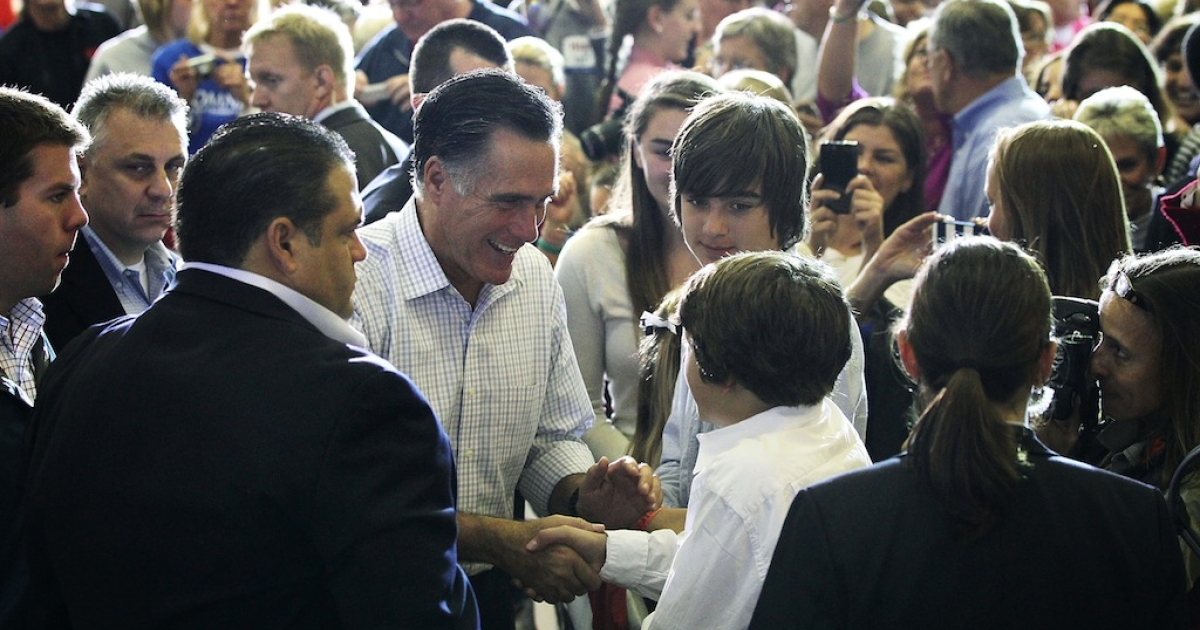 Republican US presidential candidate Mitt Romney (L) greets supporters during a campaign rally at Westerville South High School Sept. 26, 2012 in Westerville, Ohio. Romney continued his two-day 'Romney Plan For A Stronger Middle Class' bus tour in the state of Ohio.</p>
