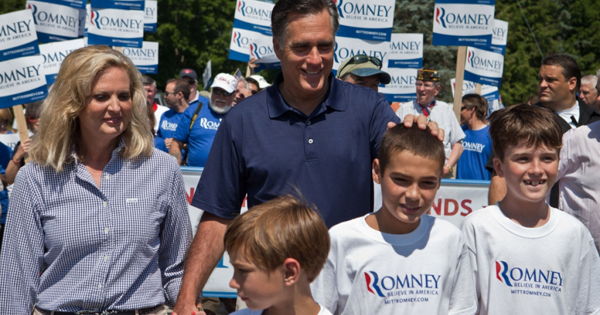 Former Massachusetts Gov. Mitt Romney and wife Ann and their family walk in the Wolfeboro Independence Day parade on July 4, 2012, in Wolfeboro, New Hampshire.</p>