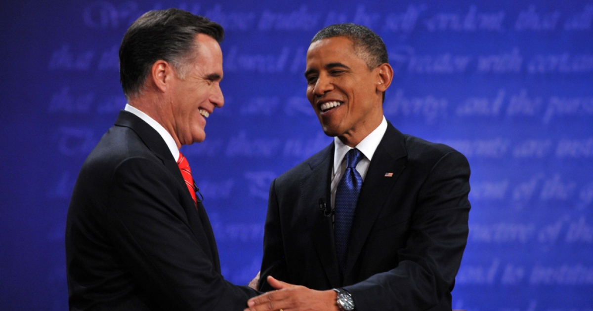 US President Barack Obama and Republican challenger Mitt Romney shake hands following their first debate at the University of Denver in Denver, Colorado, Oct. 3.</p>