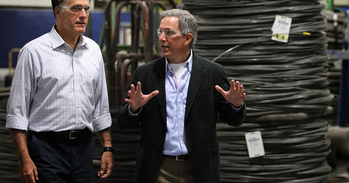 Escorted by CEO Tim Selhorst, right, Republican presidential candidate Mitt Romney tours American Spring Wire prior to a roundtable discussion with media personality Mike Rowe and business leaders on Sept. 26 in Bedford Heights, Ohio.</p>