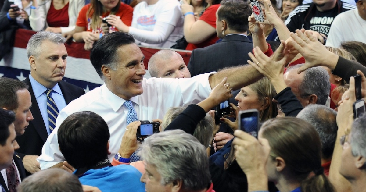 US Republican Presidential candidate Mitt Romney greets supporters at a rally at Pensacola Civic Center in Pensacola, Florida, on October 27, 2012.    AFP PHOTO/Emmanuel DUNAND        (Photo credit should read EMMANUEL DUNAND/AFP/Getty Images)</p>
