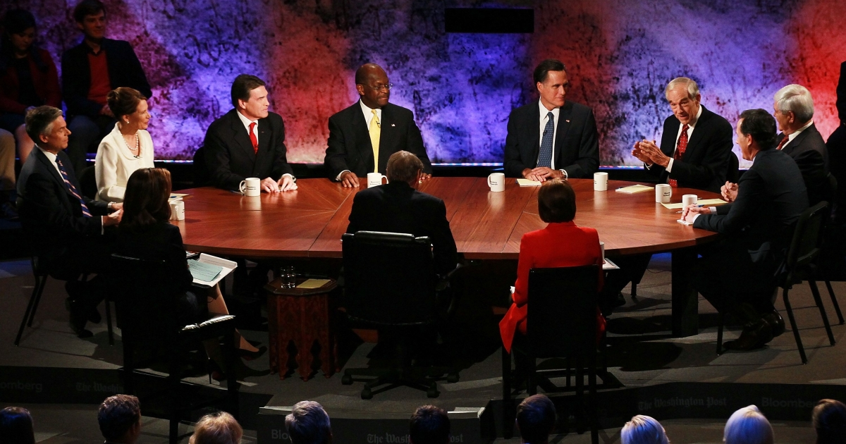 Participatants in the Republican Presidential debate hosted by Bloomberg and the Washington Post on October 11, 2011 at Dartmouth College in Hanover, New Hampshire:  (L-R) Jon Huntsman, U.S. Rep. Michele Bachmann (R-MN), Texas Gov. Rick Perry, Herman Cain, Mitt Romney, U.S. Rep. Ron Paul (R-TX), Rick Santorum and Newt Gingrich.</p>