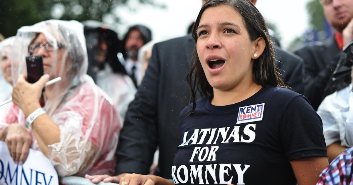 A supporter cheers US Republican presidential candidate Mitt Romney as he speaks at a campaign rally at Lake Erie College in Painesville, Ohio, on September 14, 2012.</p>