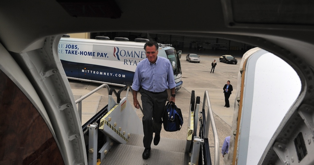 US Republican presidential candidate Mitt Romney boards his campaign plane on October 7, 2012 in Palm Beach, Florida.</p>