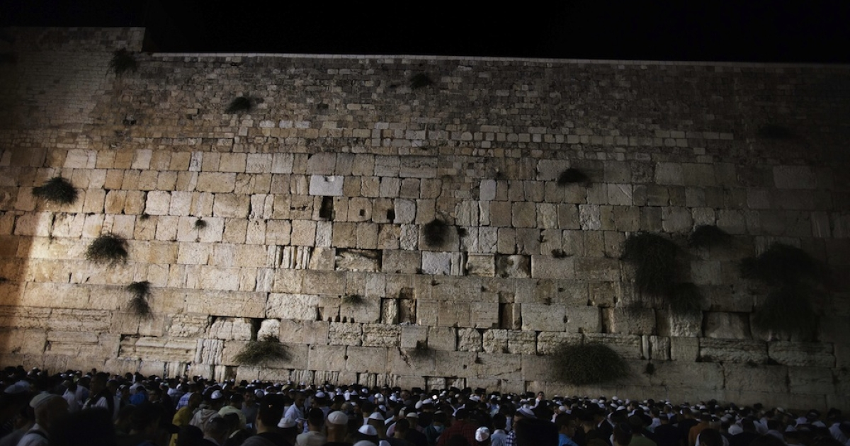 Thousands of religious Jews participate in the Slichot (forgiveness) prayer at the Western Wall, Judaism's holiest site, in the old city of Jerusalem on September 16, 2012, on the eve of the Jewish New Year. According to the Jewish calendar the world has existed for 5772 years.</p>