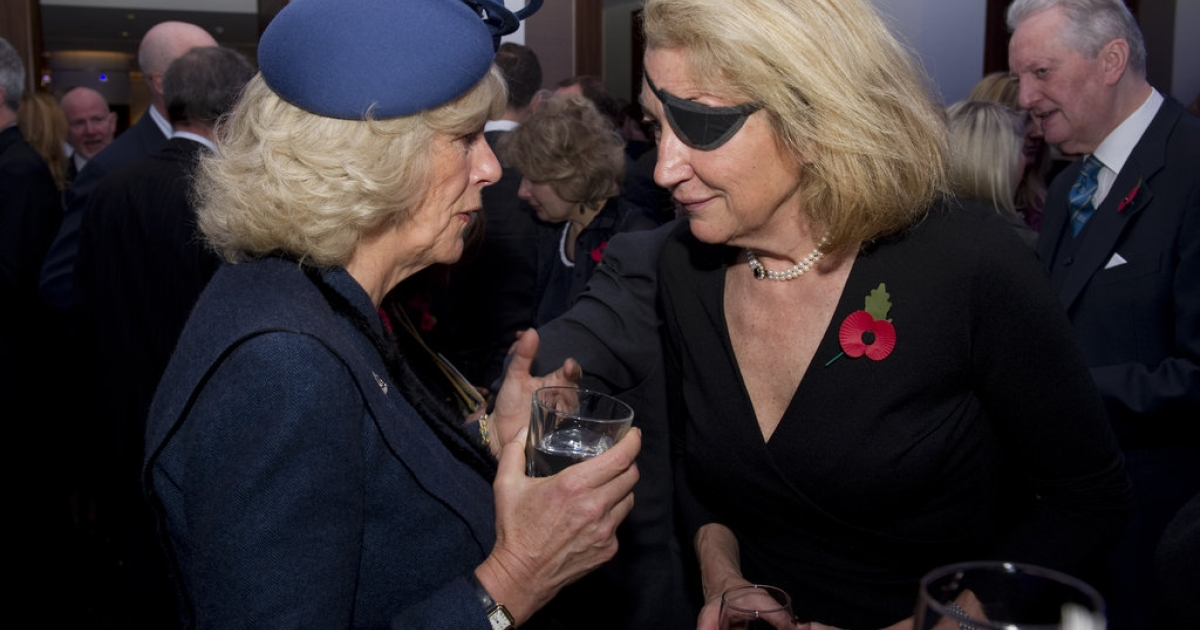 Marie Colvin of The Sunday Times (R) speaks with Camilla, Duchess of Cornwall (L) during a service at St. Bride's Church November 10, 2010 in London, England. The service commemorated journalists, cameramen and support staff who have fallen in the war zones and conflicts of the past decade.</p>