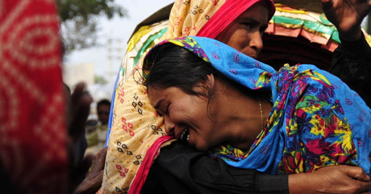 A woman cries at the Hamim Group garment factory at Ashulia on December 15, 2010 as her husband died during the fire accident. A raging fire on December 14, 2010 tore through the huge Bangladeshi garment factory that makes clothes for Western companies, killing 29 workers and injuring 100 more.</p>