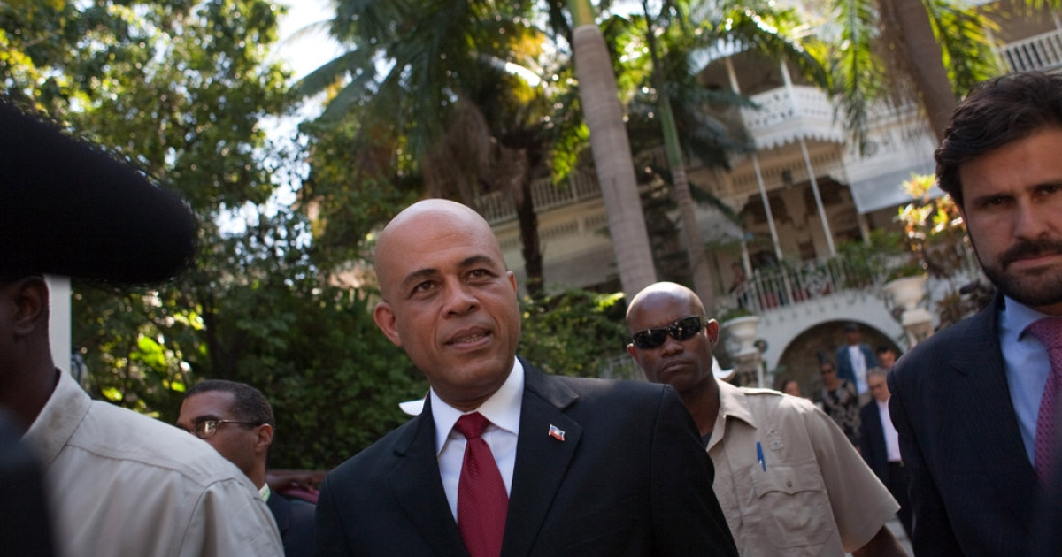 Michel Martelly, then a Haitian presidential candidate, in front of the Oloffson Hotel on February 3, 2011 in Port-au-Prince, Haiti.</p>