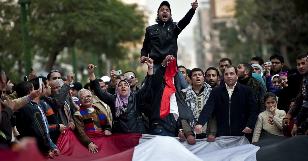 Egyptian anti-government protesters shout slogans against President Hosni Mubarak during a demonstration outside the parliament near Cairo's Tahrir Square on February 9, 2011.</p>