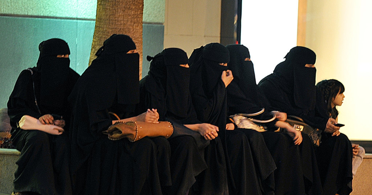 Saudi women wait for their drivers outside a shopping mall in Riyadh on September 26, 2011 a day after King Abdullah granted women the right to vote and run in municipal elections, in a historic first for the ultra-conservative country where women are subjected to many restrictions.</p>