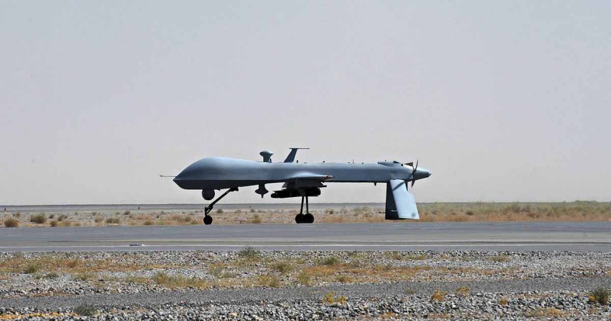 A US Predator unmanned drone armed with a missile stands on the tarmac of Kandahar military airport in 2010. Drones have been a key element of the fight against al-Qaeda in Afghanistan, Pakistan and now, possibly, Africa.</p>