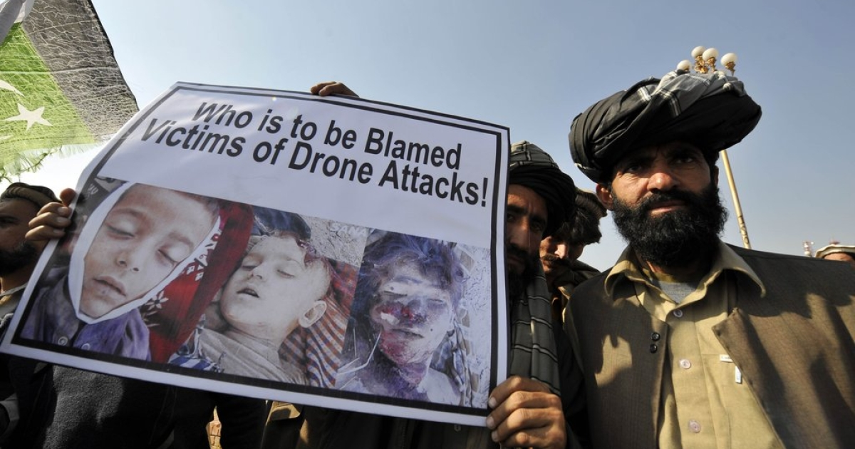 Pakistani tribesmen hold up a placard of alleged drone strike victims during a protest in Islamabad on February 25, 2012 against the US drone attacks in the country's tribal region. The protesters demanded an immediate end to drone attacks and compensation for those who lost relatives or property.</p>