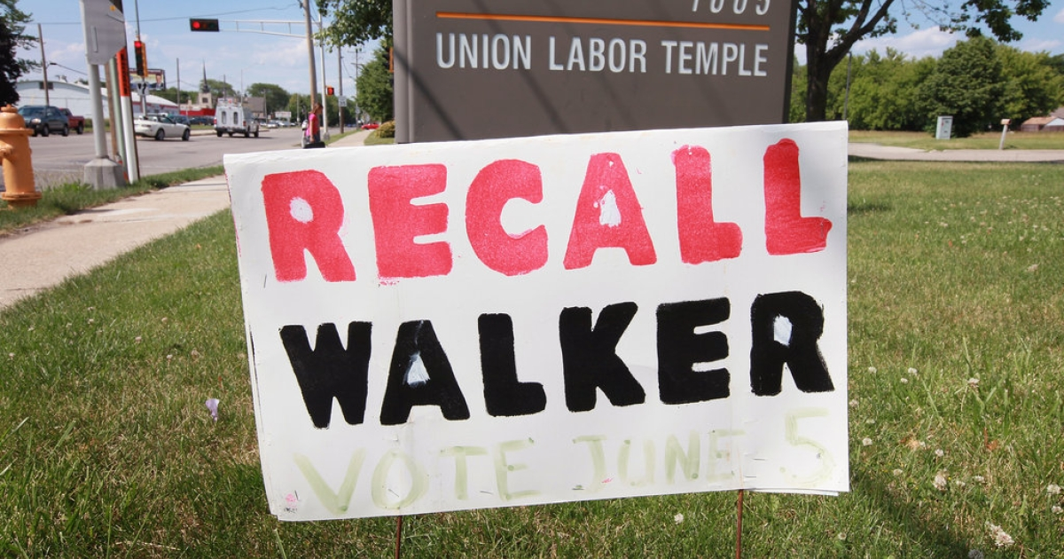 A 'recall Walker' sign sits in the front lawn of the AFL-CIO Union Hall June 4, 2012 in Janesville, Wisconsin. Democrat Milwaukee Mayor Tom Barrett tried to unseat Republican Wisconsin Governor Scott Walker in a recall election Tuesday. Opponents of Walker forced the election after the governor pushed to change the collective bargaining process for public employees in the state.</p>