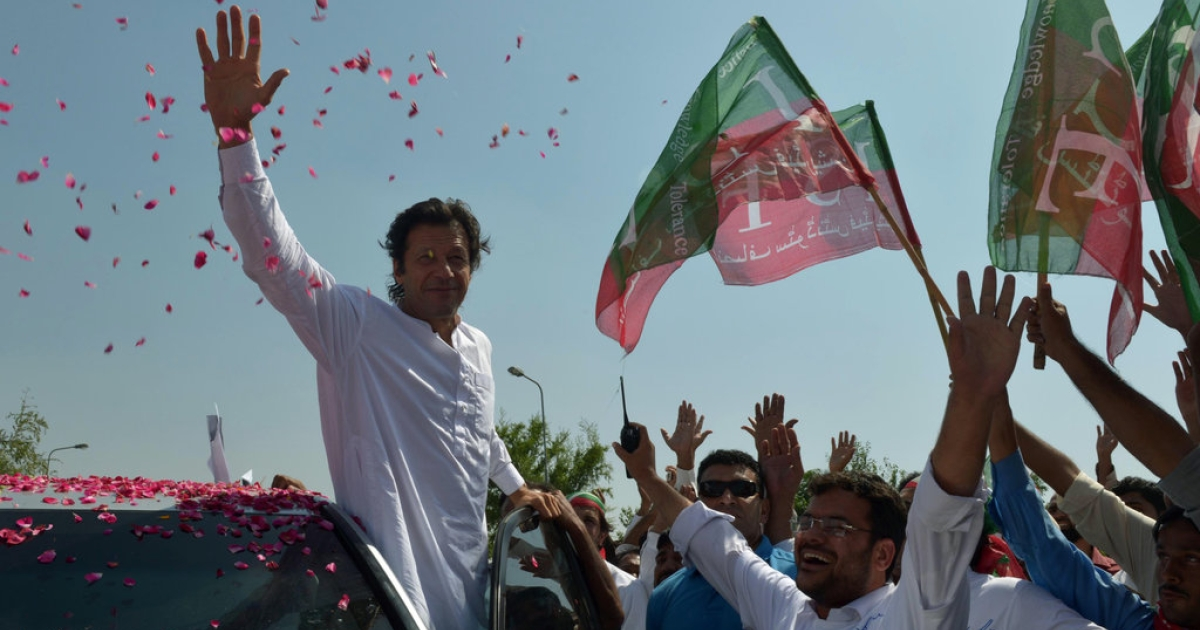 Pakistan cricketer turned politician Imran Khan waves to supporters at the start of a rally on the outskirts of Islamabad on October 6, 2012. Khan is leading western peace activists and local loyalists on a highly publicised rally to Pakistan's tribal belt in protest against US drone strikes.</p>
