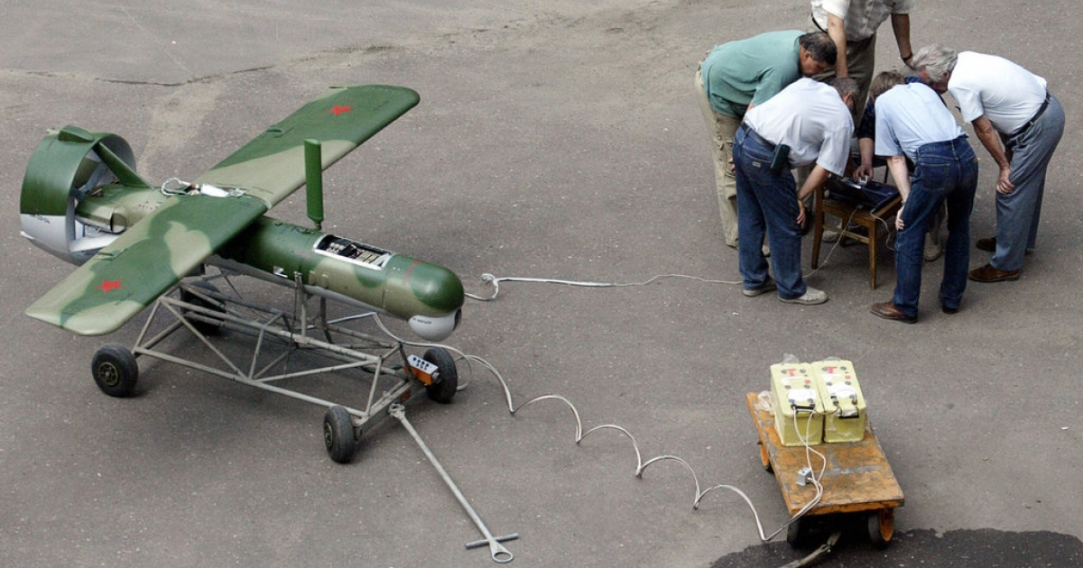 A file picture taken in July 2004 shows technicians examining pilotless photoreconnaissance in a yard of Moscow's research center.</p>