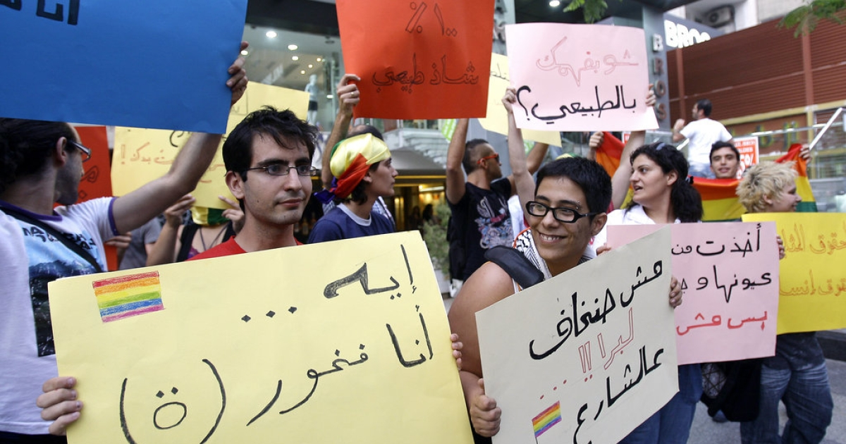 Lebanese protesters hold signs in support of homosexual people and against their discrimination during a demonstration on the eve of the International Day Against Homophobia in Beirut on May 16, 2010</p>