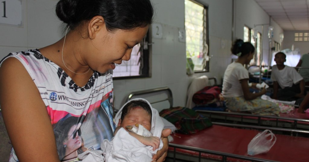 Aye Aye Thu, 30, from Myawaddy Division in Myanmar pictured at the Mae Tao Clinic in Mae Sot, Thailand with her newborn girl. Like many women unable to find quality, affordable health care in Myanmar, she crossed the border into Thailand to give birth.</p>