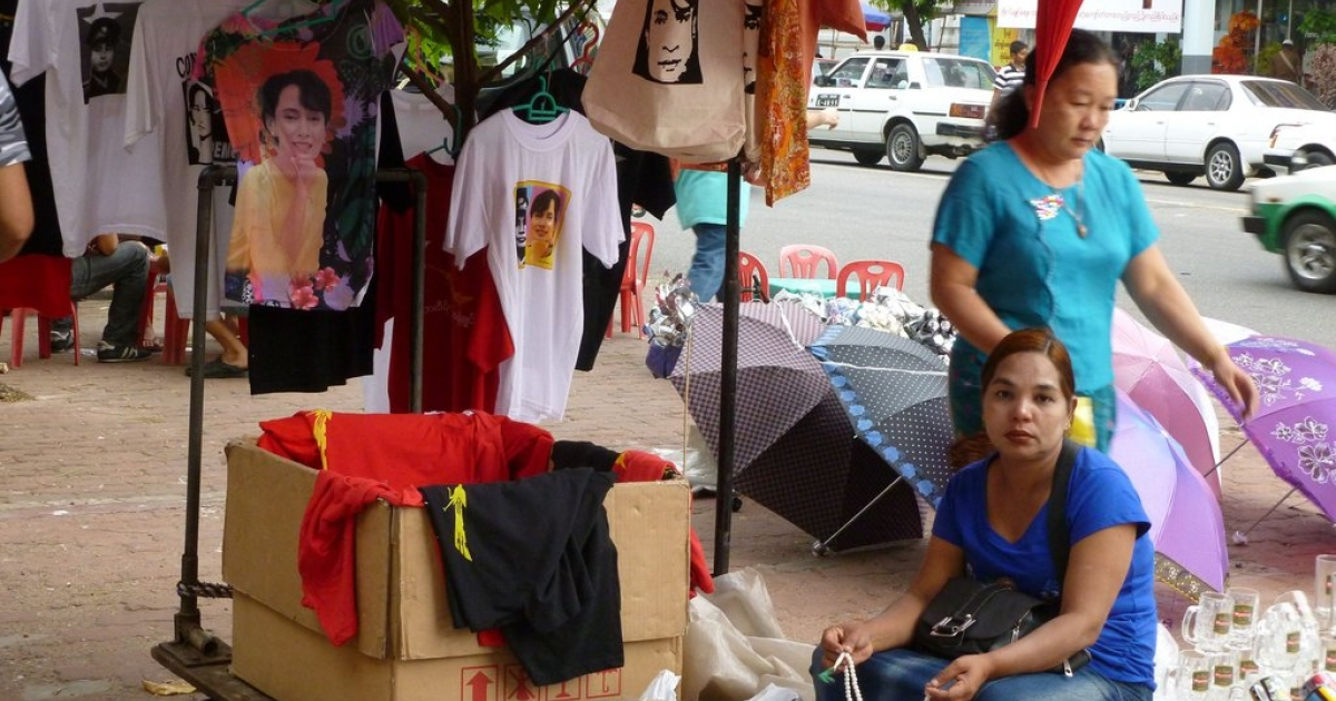 Sellers at a market in Yangon, Myanmar.</p>