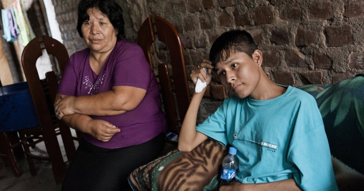 In Lima, Steven Castro Espinoza, 19, talks about taking his TB medicine as his mother, Eva Davita Espinoza Gomez, listens. Steven has multi-drug-resistant TB, as does one of his brothers. But Steven is taking medicine while his brother refuses, causing much fear in the house of the disease passing to others.</p>