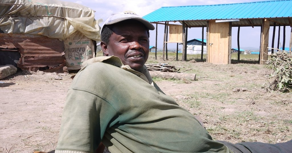 "Edward Kafuko was forced to flee his town during the 2007-2008 post- election violence that rocked the country. Since then, Kafuko has been in a series of displaced persons camps. He says it is too dangerous to return to his community. He has now been resettled to a new community in Laikipia, where after three months the<br />government had only partially finished construction. He currently lives in a makeshift home of mud and scraps. ""I never thought I would leave home, but now I can't go<br />back,"" he said.</p>"