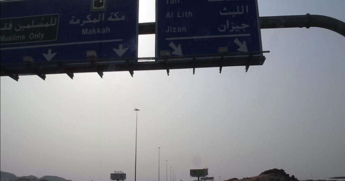 Signs above Highway 15 indicate two routes to Mecca, Islam's holiest city: One for Muslims and one for non-Muslims.</p>