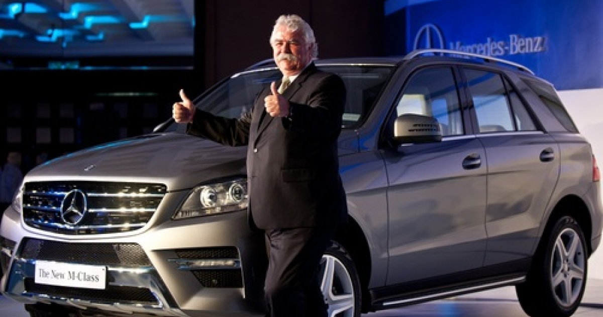Managing Director and CEO , Mercedes-Benz India Peter Honegg gestures while posing with the new edition Mercedes-Benz M-class SUV car in New Delhi on May 15, 2012.  Presumably, now he's doing something else with his thumbs.</p>