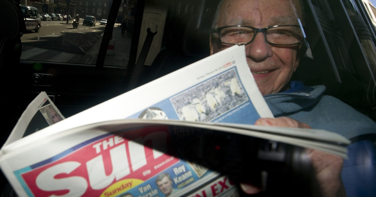 News Corporation Chief Rupert Murdoch holds up a copy of the newly launched 'The Sun on Sunday' newspaper as he leaves his London home on February 26, 2012. Rupert Murdoch will be called in to testify by the Leveson inquiry into media ethics in late April or early May, sources say.</p>