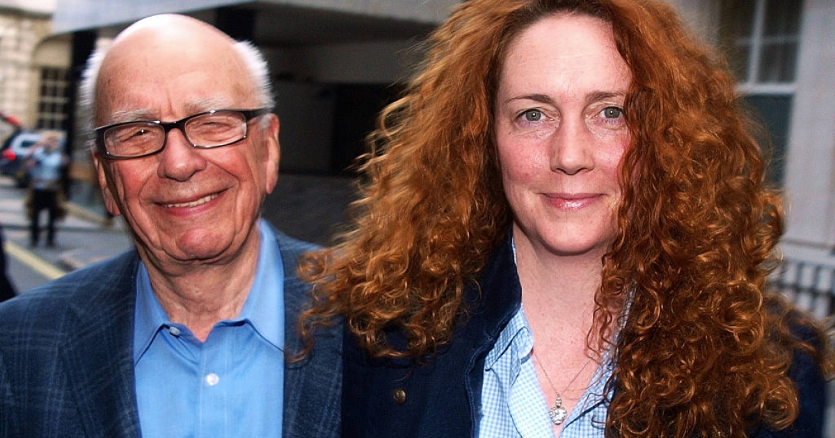Rebekah Brooks and Rupert Murdoch leaving Murdoch's London residence. Murdoch arrived in London on July 10, 2011 to take charge of News of the World's phone hacking incident.</p>