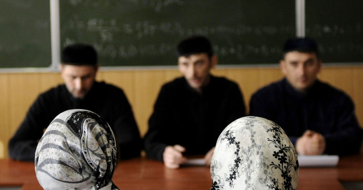 Headscarf-wearing female students attend classes at the Grozny State Oil Institute in Grozny, Chechnya, on March 21, 2011.</p>