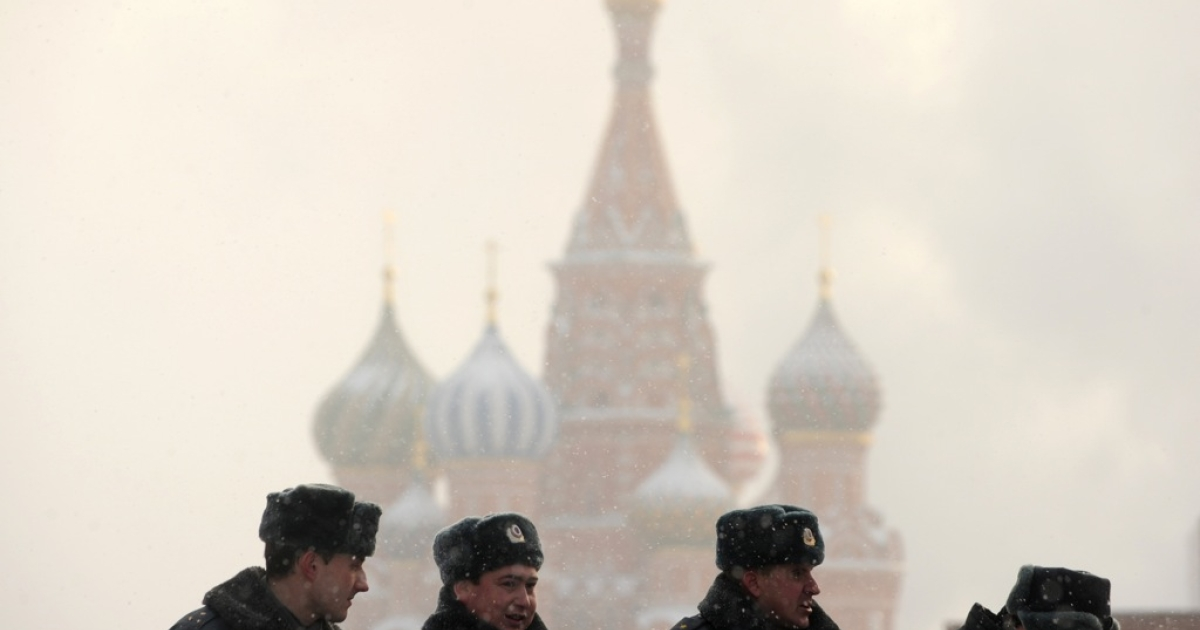 Russian police officers stand guard on January 21, 2012 during snowfall on Red Square in Moscow.</p>