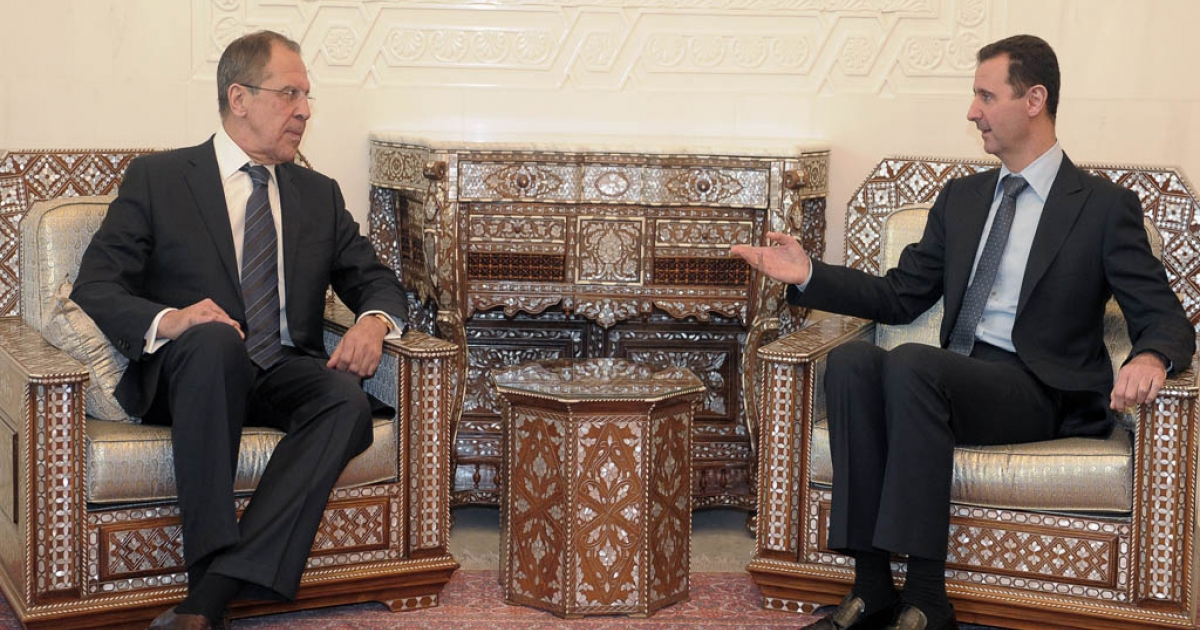 Russia's Foreign Minister Sergei Lavrov has denied any plans to offer asylum to Syrian President Bashar al-Assad after his government falls.<br />Assad (R) speaks with Lavrov during their  meeting at the presidential palace in Damascus, on February 7, 2012.</p>