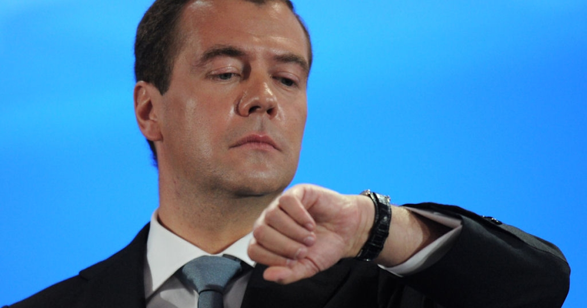Russian President Dmitry Medvedev checks his watch during a news conference on May 18, 2011 at the Skolkovo center outside Moscow.</p>