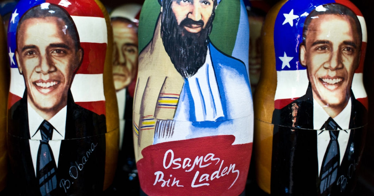 Traditional Russian matryoshka dolls, one showing U.S. President Barack Obama and another showing Al Qaeda leader Osama bin Laden, displayed for sale at an open air market in Moscow on Jan. 19, 2009.</p>