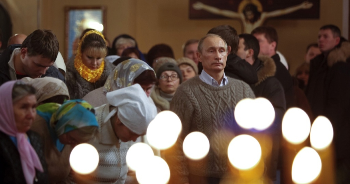 Russian Prime Minister Vladimir Putin (R) attends an Orthodox Christmas service in the XIX century church of the Protecting Veil of the Mother of God in Turginovo, about 160 kilometers northwest of Moscow on Jan. 7, 2011. Thirteen days after Western Christmas, on Jan. 7, the Russian Orthodox Church celebrates its Christmas, in accordance with the old Julian calendar.</p>
