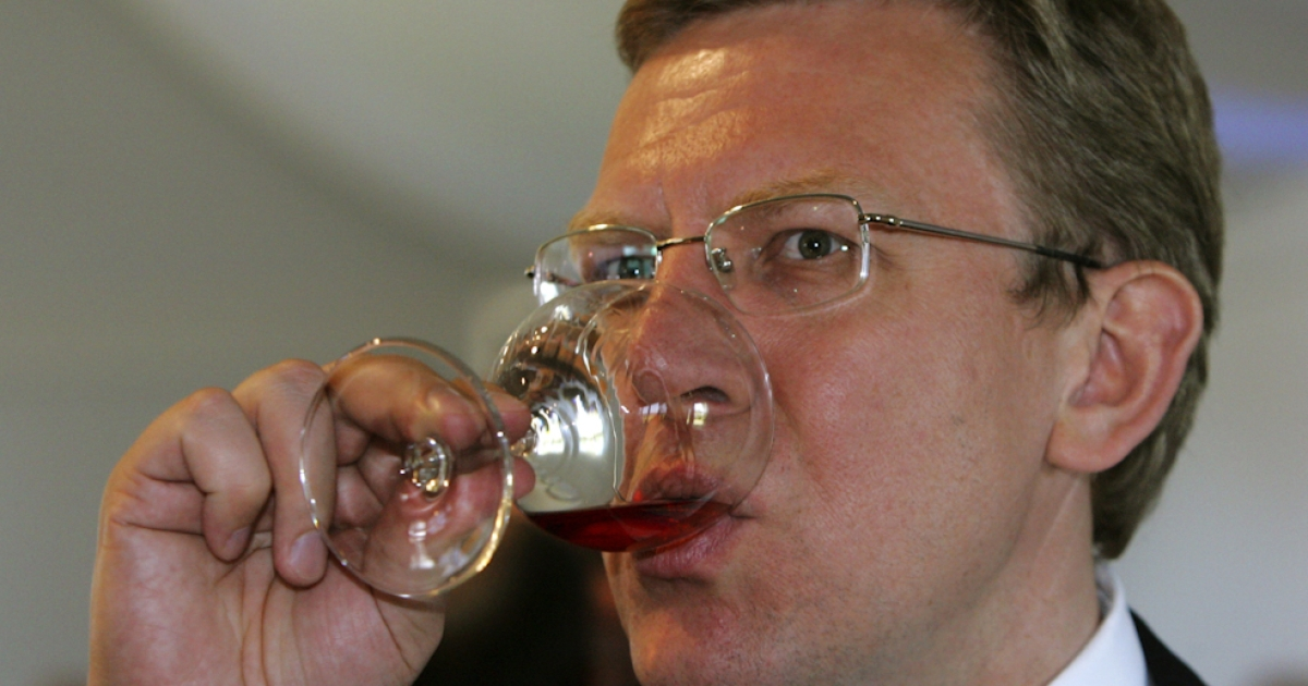 Russian Finance Minister Alexey Kudrin drinks a glass of wine during a reception at a G8 finance ministers meeting.</p>