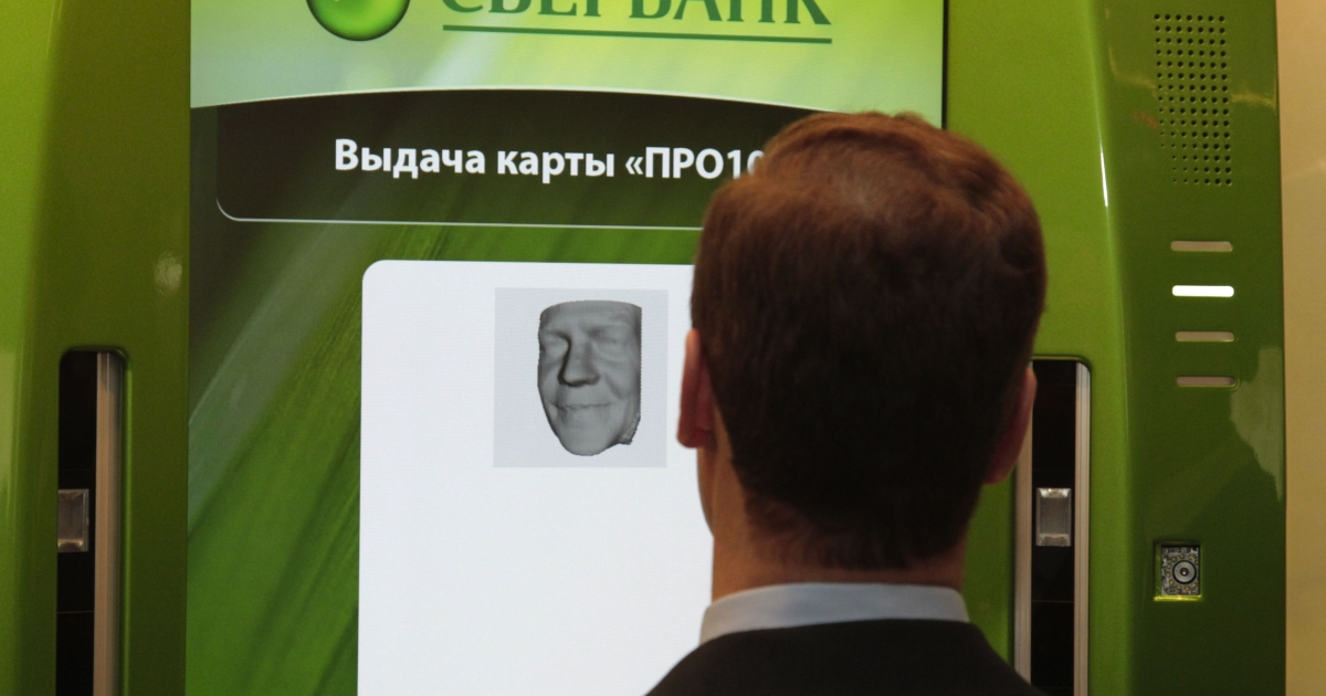 Russian President Dmitry Medvedev looks at Sberbank card terminal in Moscow, on February 28, 2011.</p>