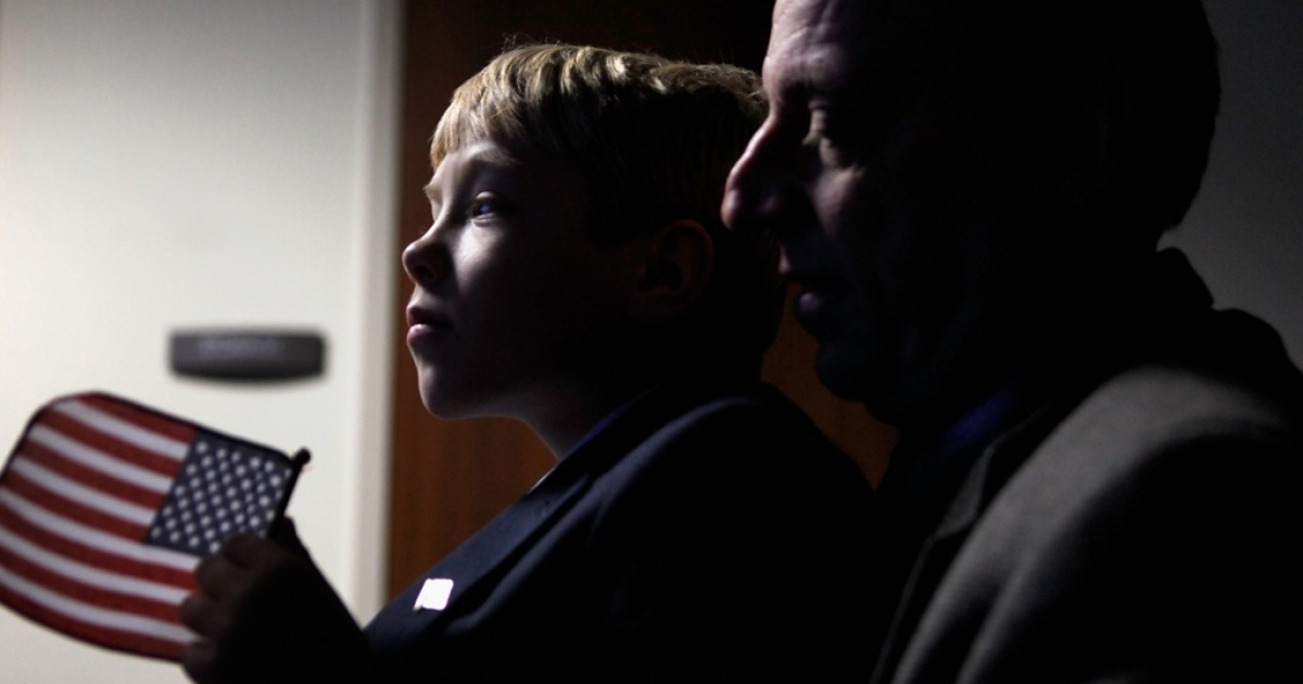 A Russian-born boy with his American adoptive father in Washington, DC, in 2011. Russia is seeking to ban US citizens from adopting Russian children.</p>