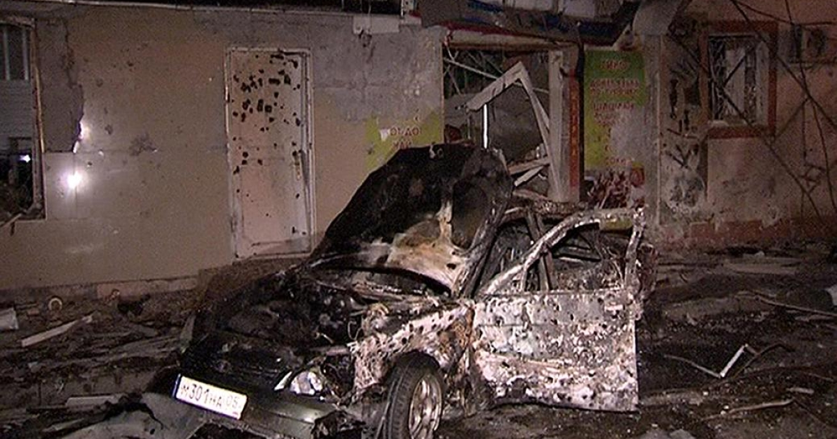 A damaged car at the site of the twin explosions in Makhachkala, the capital of Russia's North Caucasus region of Dagestan, early on Sept. 22 2011. Two more car bombings at a checkpoint near the capital occured on May 3 2012.</p>