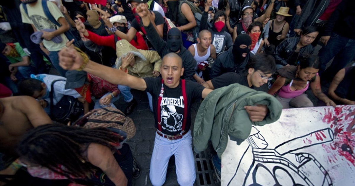 Students take part in a demo during the anniversary of the massacre of Tlatelolco, in Mexico City, on October 2, 2010. Mexico commemorates the 42th anniversary of a deadly clampdown on student protesters this week with the details of the massacre still unclear, the perpetrators untried, and impunity as widespread as ever. As student movements shook the world in 1968, Mexican security forces killed at least 44 protesting students in the country's capital 10 days before the start of the Olympics here, and rapidly cleared up the evidence. Social organizations claim there were over 300 people killed</p>