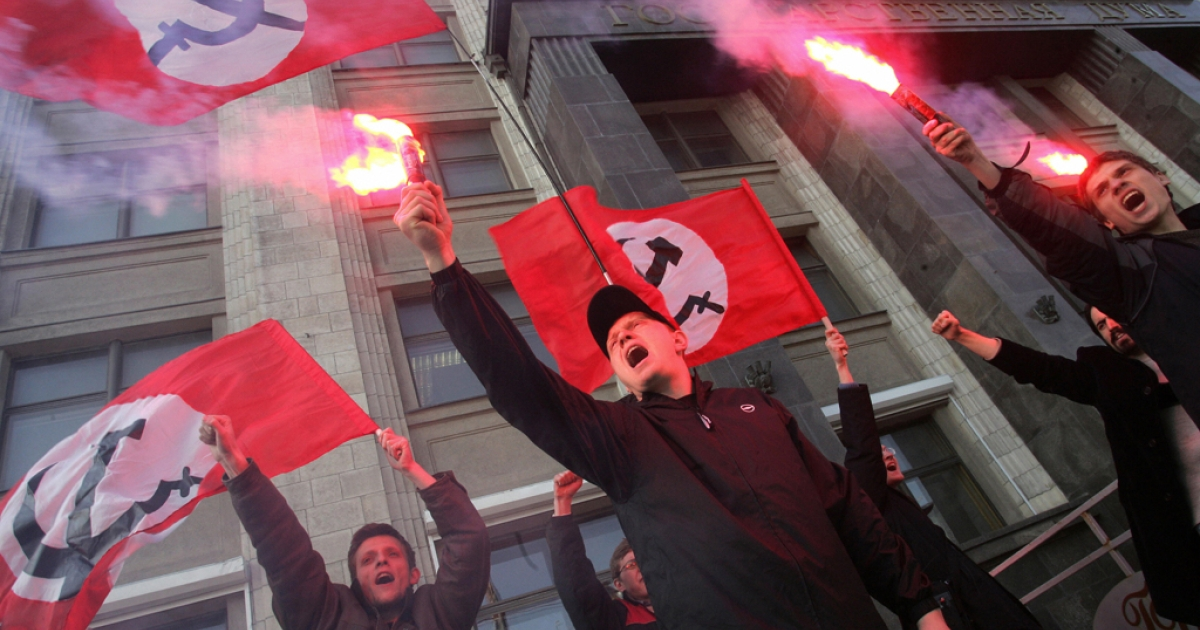 Members of the ultra-left Russian National Bolshevik party (NBP) shouting slogans during an unsactioned protest outside the Russian Parliament building in Moscow. The NBP, headed by opposition favorite Eduard Limonov, has been placed on a Russian terrorist watch list.</p>