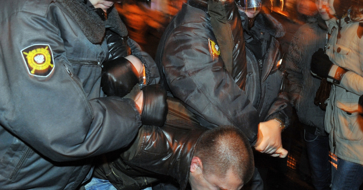 Police detain an activist during a rally in Saint-Petersburg, on December 6, 2011. More protests are being planned through the week after accusations of voter fraud emerged from Putin's United Russia.</p>
