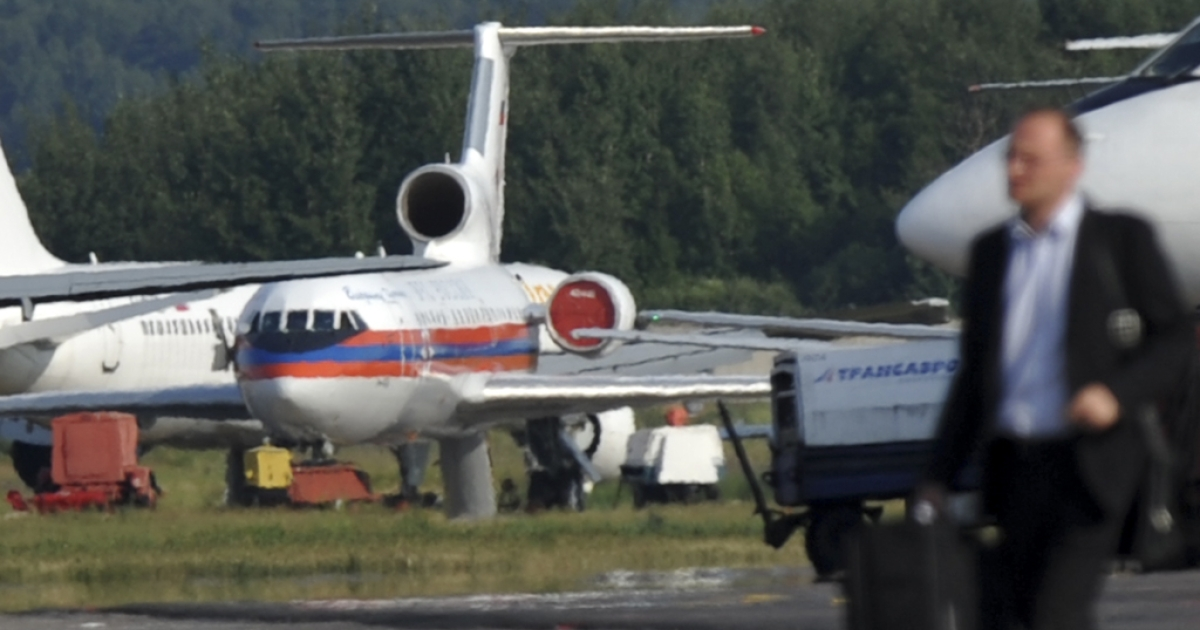 A man walks near a Yak-42 aircraft at the Domodedovo airport in Moscow. A Russian airliner carrying a hockey team crashed September 7, 2011 near Yaroslavl, in western Russia. Reports said the plane was a Yak-42.</p>