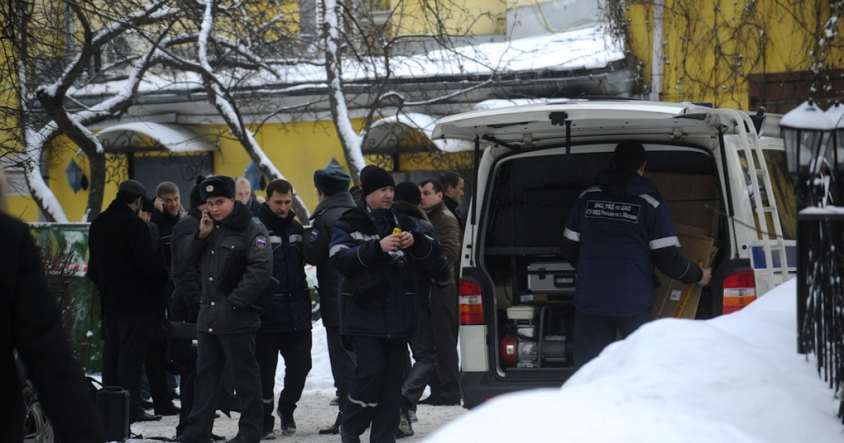 Russian police investigating the murder of Aslan Usoyan gather outside the restaurant where the crime boss was gunned down on Wednesday.</p>